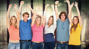 Composite image of a group of people with their hands raised Royalty Free Stock Photos