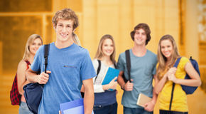 Composite image of a group of smiling college students look into the camera as one man stands in fro Royalty Free Stock Photos
