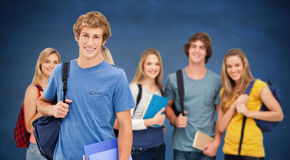 Composite image of a group of smiling college students look into the camera as one man stands in fro Stock Photos