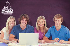 Composite image of a group of students with a laptop look into the camera Royalty Free Stock Photography