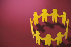 Composite image of  group of yellow little person holding hands Royalty Free Stock Photography