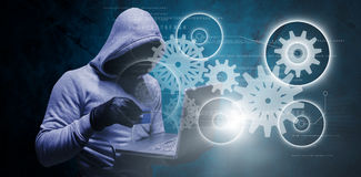 Composite image of hacker using credit card for cyber crime Royalty Free Stock Images