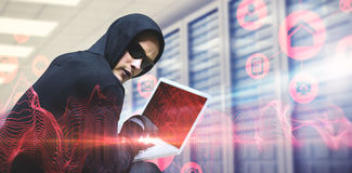 Composite image of hacker using laptop to steal identity. Hacker using laptop to steal identity against abstract blue glowing black background royalty free stock photos