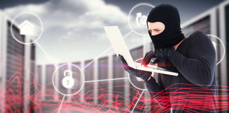 Composite image of hacker using laptop to steal identity Royalty Free Stock Photos