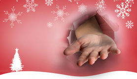 Composite image of hand bursting through paper Royalty Free Stock Images
