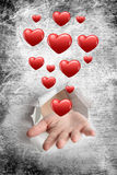Composite image of hand bursting through paper Royalty Free Stock Photo