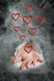 Composite image of hand bursting through paper Stock Image
