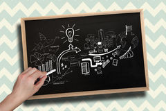 Composite image of hand drawing brainstorm with chalk