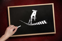 Composite image of hand drawing fingers on tightrope with chalk Stock Photography