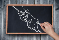 Composite image of hand drawing handshake with chalk Royalty Free Stock Photography