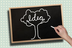 Composite image of hand drawing idea tree with chalk Royalty Free Stock Photos
