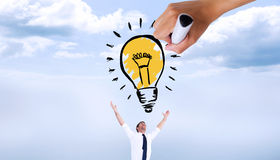 Composite image of hand drawing light bulb Stock Photography