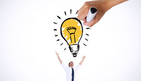 Composite image of hand drawing light bulb Stock Images
