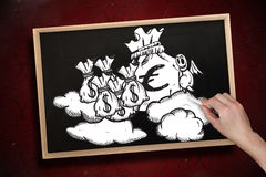 Composite image of hand drawing money bags with chalk Royalty Free Stock Images