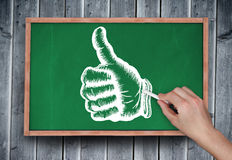 Composite image of hand drawing thumbs up with chalk Royalty Free Stock Image