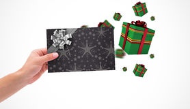 Composite image of hand holding card Stock Images