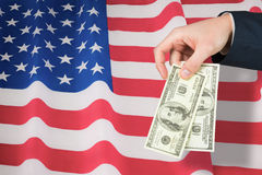 Composite image of hand holding hundred dollar bills Royalty Free Stock Images