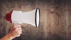 Composite image of hand holding megaphone Royalty Free Stock Photos