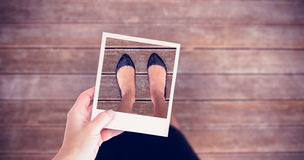 Composite image of hand holding polaroid picture Royalty Free Stock Images