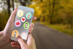 Composite image of hand holding smartphone Royalty Free Stock Photos