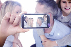 Composite image of hand holding smartphone showing Royalty Free Stock Photo