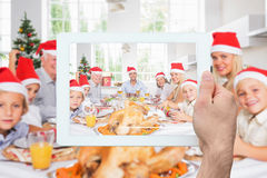 Composite image of hand holding tablet pc Royalty Free Stock Image