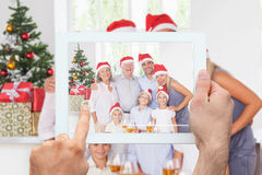 Composite image of hand holding tablet pc Stock Images