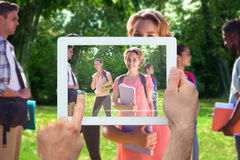 Composite image of hand holding tablet pc Stock Photos