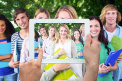 Composite image of hand holding tablet pc. Hand holding tablet pc against park Royalty Free Stock Photo