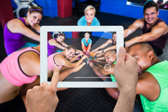 Composite image of hand holding tablet pc Stock Image