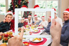 Composite image of hand holding tablet pc Stock Photo