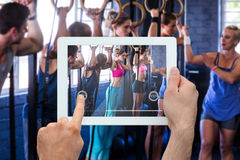 Composite image of hand holding tablet pc Royalty Free Stock Photo