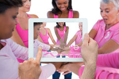 Composite image of hand holding tablet pc Royalty Free Stock Images