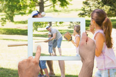 Composite image of hand holding tablet pc Royalty Free Stock Photos