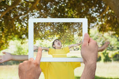 Composite image of hand holding tablet pc Stock Photography