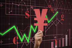Composite image of hand holding yen sign. Hand holding yen sign against red arrow Stock Photos