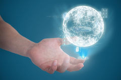 Composite image of hand of man pretending to hold an invisible object. Hand of man pretending to hold an invisible object against blue Stock Photography