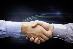 Composite image of hand shake in front of wires Stock Images