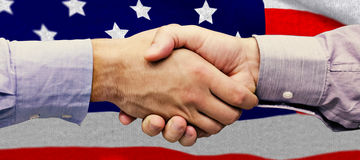 Composite image of hand shake in front of wires Royalty Free Stock Photo