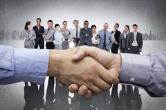 Composite image of hand shake in front of wires Royalty Free Stock Photos