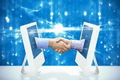 Composite image of hand shake in front of wires. Hand shake in front of wires against digitally generated image of abstract pattern Royalty Free Stock Images