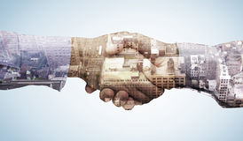 Composite image of hand shake in front of wires. Hand shake in front of wires against new york Stock Photos