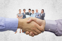 Composite image of hand shake in front of wires. Hand shake in front of wires against white background Royalty Free Stock Photo