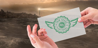 Composite image of hand showing card Royalty Free Stock Images