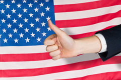 Composite image of hand showing thumbs up Stock Images