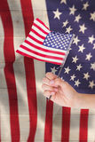 Composite image of hand waving american flag Royalty Free Stock Photos