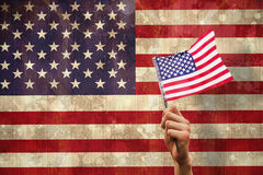 Composite image of hand waving american flag Stock Images