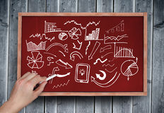 Composite image of hand writing brainstorm with chalk Royalty Free Stock Photos