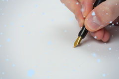 Composite image of hand writing with fountain pen Stock Photo