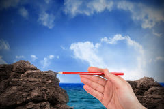 Composite image of hand writing with a pencil Royalty Free Stock Images